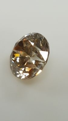 0.71 ct - Round Brilliant - Brown - VS1
