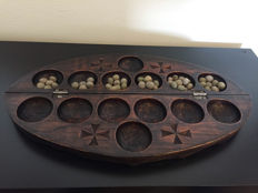 Ancient African Oware game from teak wood and bonduc seeds