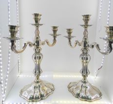 Pair of candelabra for three lights each, Spanish silver, punched. La onza de oro