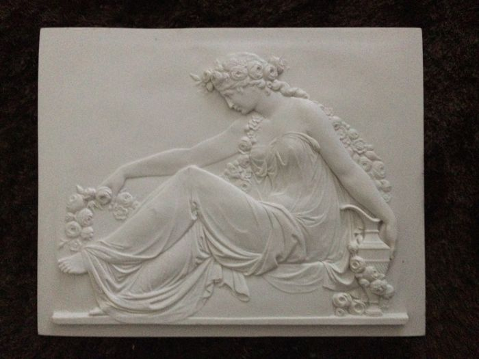 Relief of beautiful woman in the style of ancient Greece