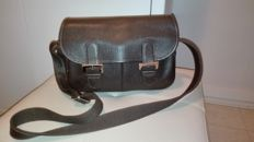 Longchamp – vintage handbag with strap.