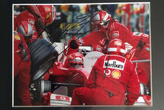 Professionally framed image, personally signed by Michael Schumacher