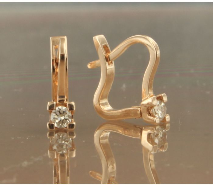 14 kt rose gold solitaire dangle earrings set with brilliant cut diamond, approx. 0.22 carat in total, size is 1.2 cm long x 4.1 mm wide.