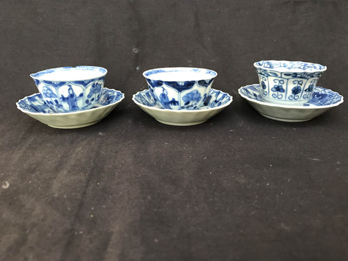 Three blue and white porcelain cups and saucers – China – 18th century
