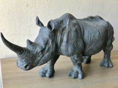 Very large handmade sculpture of a rhinoceros.
