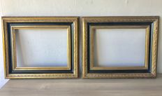 Two large gold-plated picture frames - inside measurements are 40.5 x 30.5 cm - groove depth is 1.00 cm.