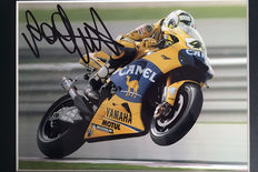 Professionally framed image, personally signed by Valentino Rossi