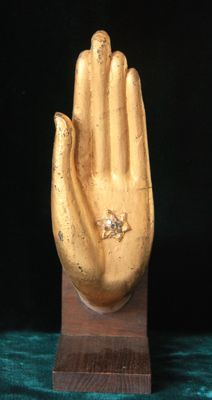 Buddha hand on wooden stand - Thailand - second half of the 20th century