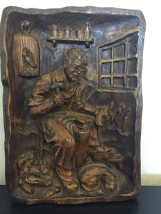Antique wood carving with craft shoe maker