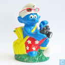 Smurf with backpack and camera