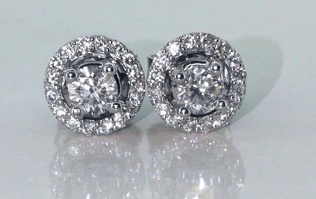 Day & Night earrings, set with brilliant cut diamonds of 0.68 ct in total