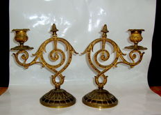 A pair of gilt bronze candelsticks, 20th century
