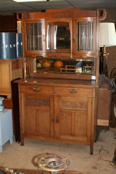Antique tea time Buffet Cabinet of oak wood with Facet cut glass and a mirror, 1930s