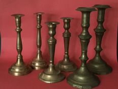 Three sets of bronze candlesticks, early 20th century