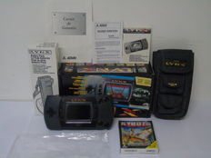 Atari Lynx 2 boxed with a game Xybots , Battery Pack and travel bag