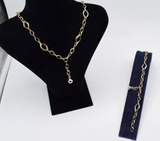 Gold  14 carat necklace with bracelete , set of  white and yellow  gold