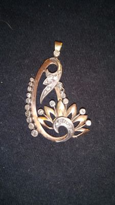 Gold and silver pendant with diamonds.