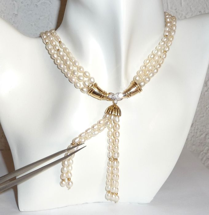 Multi-row cultivated pearl necklace with a heavy 14kt gold middle section + 0.35ct. Diamonds - 46cm