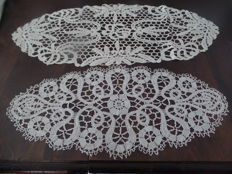 Two rare oval table doilies made from Bruges bobbin lace.