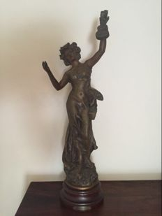 A zamac sculpture of a graceful lady after  Kossowski, late 20th century