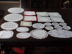 Lot of 22 crochet and embroidered doilies.