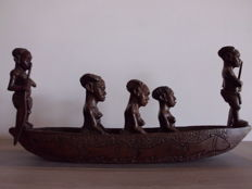 Handmade and carved wooden boat with 5 figures