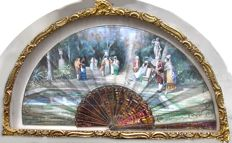 A painted paper and simulated shell folding fan, signed M Ba.net, Bach Madrid, in a fitted case - Spain - 19th century