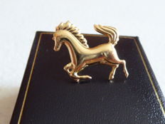 18 kt gold brooch in the shape of a horse