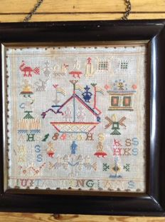 An embroidered sampler - the Netherlands - dated 1883