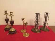 A pair of beautiful red marble candlesticks from the 1st half of the 20th century with decorated brass applications and claw legs, a pair of special coper candlesticks decorated with beaded garlands, also 1st half 20th century, plus a set of two in high f