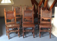 A set of 6 cut oak hall chairs - England - mid-19th century