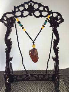 Myanmar amber tag work, heavy 21.8 grams: Amber length of 54 mm, width of 31 mm