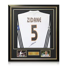 Zinedine Zidane - Signed en framed Real Madrid Champions League shirt + COA.