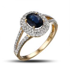 14 kt yellow gold ring with a dark blue sapphire (1.15 ct) and natural diamonds G-H/SI1 (in total 0.48 ct)