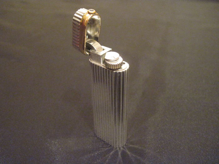 Cartier silver plated and gold lighter with stone