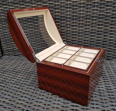Exclusive watch storage box  for 16 watches, made of burgundy-coloured wood.