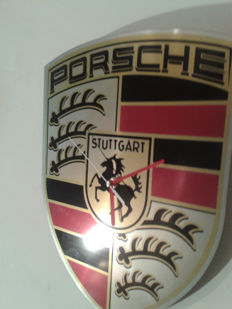 PORSCHE logo as the clock on the wall.Stainless steel INOX. 38/29cm