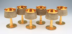 A set of six silver and gilt goblets, textured bark design, London - 1971