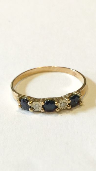 14 kt Gold ring with diamond and blue sapphire Size: 18 (57)