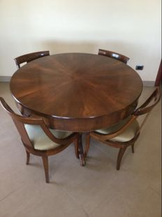 "A Louis Philippe walnut centre table - together with four chairs and an armchair, all ""en gondole"" - Italy - 19th century"