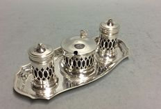 Silver plated pepper, salt and mustard set, with blue glass, on a serving tray, England, ca 1935