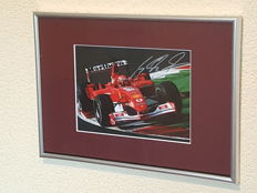 Michael Schumacher - Benneton/Ferrari 7-time world champion F1  - beautiful framed hand-signed photo + COA.
