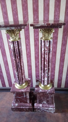 A pair of veined red marble pedestals, late 19th century/early 20th century