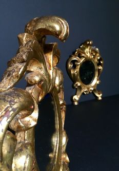 Pair of small mirrors, in lacquered antique gold, Louis XV style.