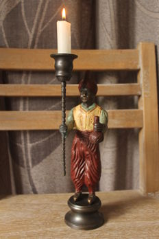 Bronze statue of a man with candle holder - Mid 20th century.
