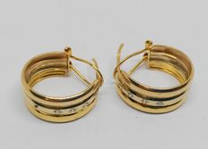 Earrings in 18 kt yellow gold with zirconias