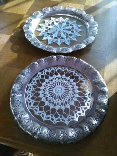 Very beautiful two openwerkt silvery tray's with double glass in and hand knotted guiper between the glasses.!!!