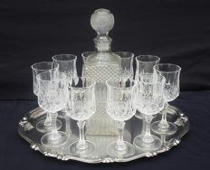 Lot of 10 glasses, and one cut crystal bottle with geometric shapes France - second half of the 20th century.