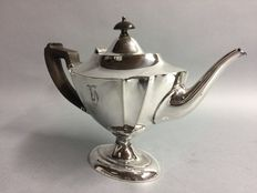 Tea pot on low base with brown wooden handle, England, ca 1900