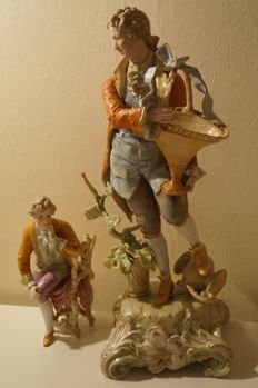 Porcelain figure of a gardener and another figure of a beau.